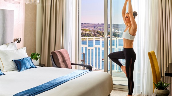 hotel-slovenija-storytelling-yoga-standing-pose-hands-up-balcony-sea-view-double-room-18
