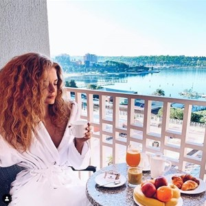enjoying-breakfast-balcony-sea-view-lifeclass-portoroz.jpg